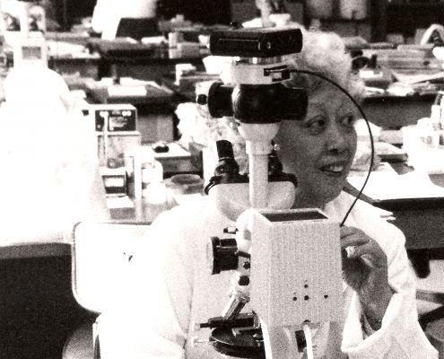 Dr. Irene Uchida working in a lab